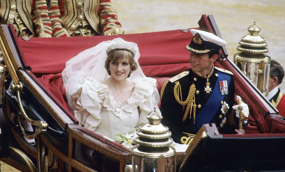 Diana, Princess of Wales and Prince Charles ride in a carriage after their wedding at St. Paul's Cathedral July 29, 1981 in London, England.   (Photo by Anwar Hussein/WireImage) Photo: Anwar Hussein, Getty Images / 2007 Anwar Hussein