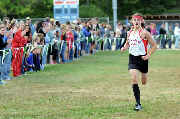 Guilderland's Noah Carey comes in second during the Springstead Invitational Cross Country Meet on Friday, Sept. 12, 2014, at Colonie Town Park in Colonie, N.Y. (Cindy Schultz / Times Union) Photo: Cindy Schultz / 00028531A