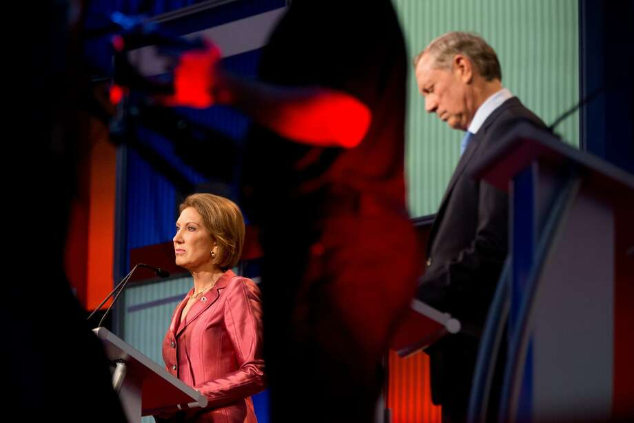 Republican presidential candidates Carly Fiorina, and former New York Gov. George Pataki participate in a pre-debate forum at the Quicken Loans Arena, Thursday, Aug. 6, 2015, in Cleveland. Seven of the candidates have not qualified for the primetime debate. (AP Photo/Andrew Harnik) Photo: Andrew Harnik, Associated Press