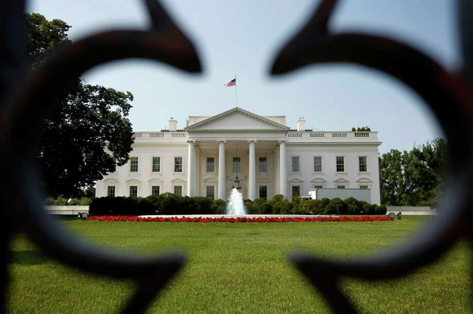 "FILE-In this Thursday, June 28, 2012, file photo, The White House is seen in Washington. High unemployment threatens not only President Barack Obama's re-election prospects. It will also bedevil whoever occupies the White House for the next four years. According to 32 economists surveyed by the Associated Press, the unemployment rate, now 8.2 percent, will exceed its ""normal"" range of 5 to 6 percent until 2015 or later. The presidential winner in November will serve through 2016. (AP Photo/Pablo Martinez Monsivais, File) Photo: Pablo Martinez Monsivais, STF / AP2012"