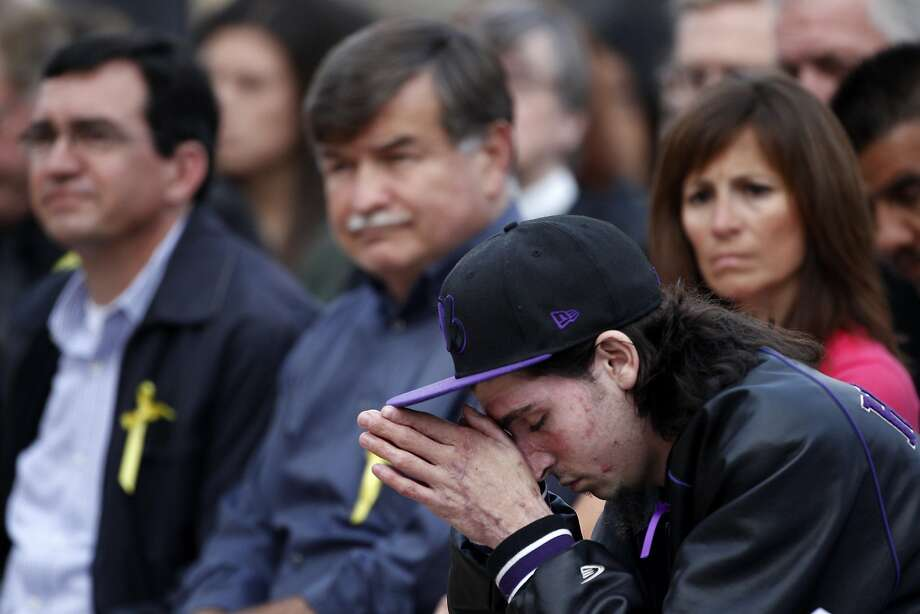 Joe Ruigomez bows his head during the memorial to mark the one-year anniversary of the San Bruno explosion in the Crestmoor neighborhood in which he was badly burned. Photo: Lacy Atkins, The Chronicle