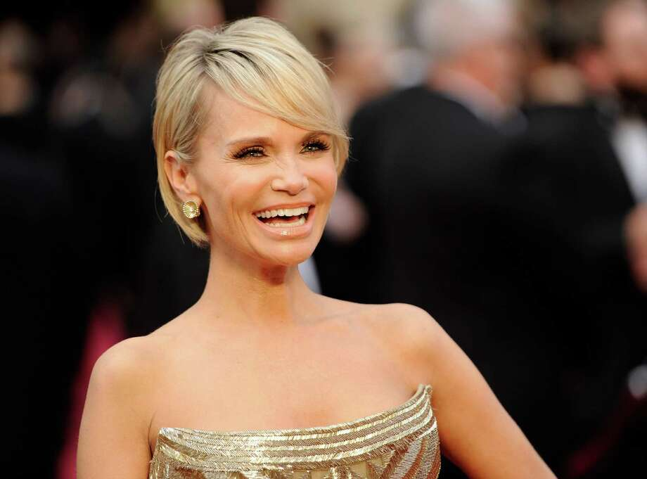 "FILE - This March 2, 2014 file photo shows actress Kristin Chenoweth at the Oscars in Los Angeles. Chenoweth is chugging back to Broadway in the stylish screwball musical ""On the Twentieth Century."" Producers said Tuesday, May 13, 2014, that the Tony- and Emmy-winner will co-star with Peter Gallagher in the show adaptred from the the 1934 film with lyrics by Betty Comden and Adolph Green and music by Cy Coleman. Scott Ellis will direct and Warren Carlyle will choreograph. (Photo by Chris Pizzello/Invision/AP, FIle) ORG XMIT: NYET218 Photo: Chris Pizzello / Invision"