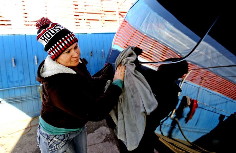 PHOTOS: Things a barrel of oil is cheaper thanFull-service car washMirna Abrego cleans a vehicle at the Keep It Clean car wash Monday, Jan. 5, 2015, in Houston, Texas. Luxury auto detailing -- including a hand wax, seat shampooing and a wipe down of the wheels -- costs about $120, or double the cost of a barrel of West Texas Intermediate. Gary Coronado / Houston Chronicle ) Photo: Gary Coronado, Houston Chronicle
