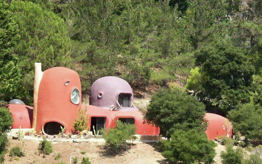 The Flintstone House is perched on a hillside in Hillsborough, Calif., overlooking Interstate 280. Photo: Facebook