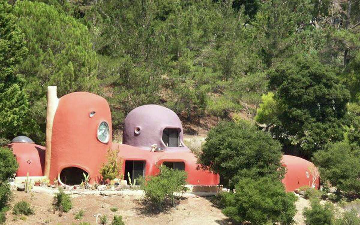 The Flintstone House is perched on a hillside in Hillsborough, Calif., overlooking Interstate 280.
