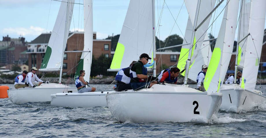 Noroton Yacht Club (yellow trimmed sails) in a strong combination in the finals against  St. Francis Yacht Club. Photo: Contributed / Contributed / Darien News