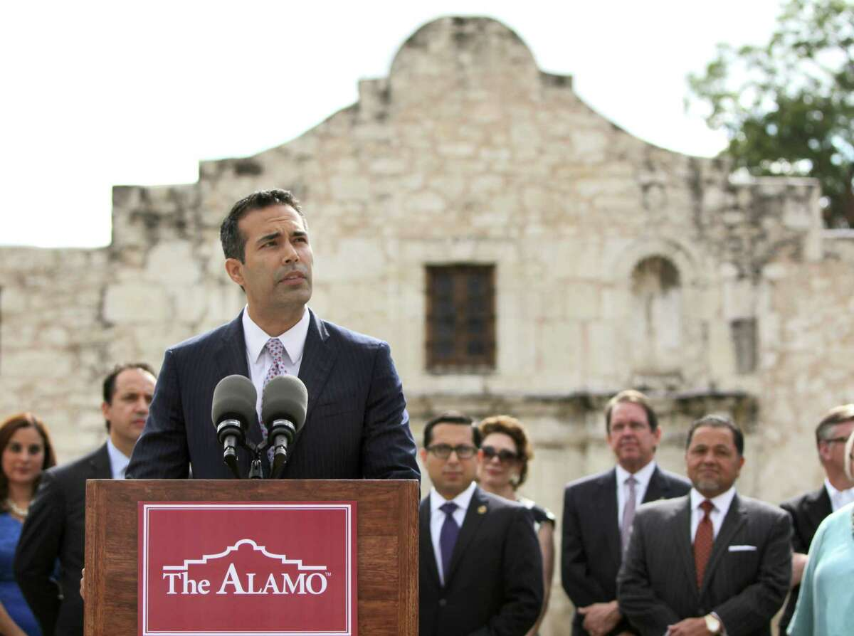 Texas Land Commissioner George P. Bush, backed by state and local elected leaders, speaks in front of the Alamo on Wednesday.