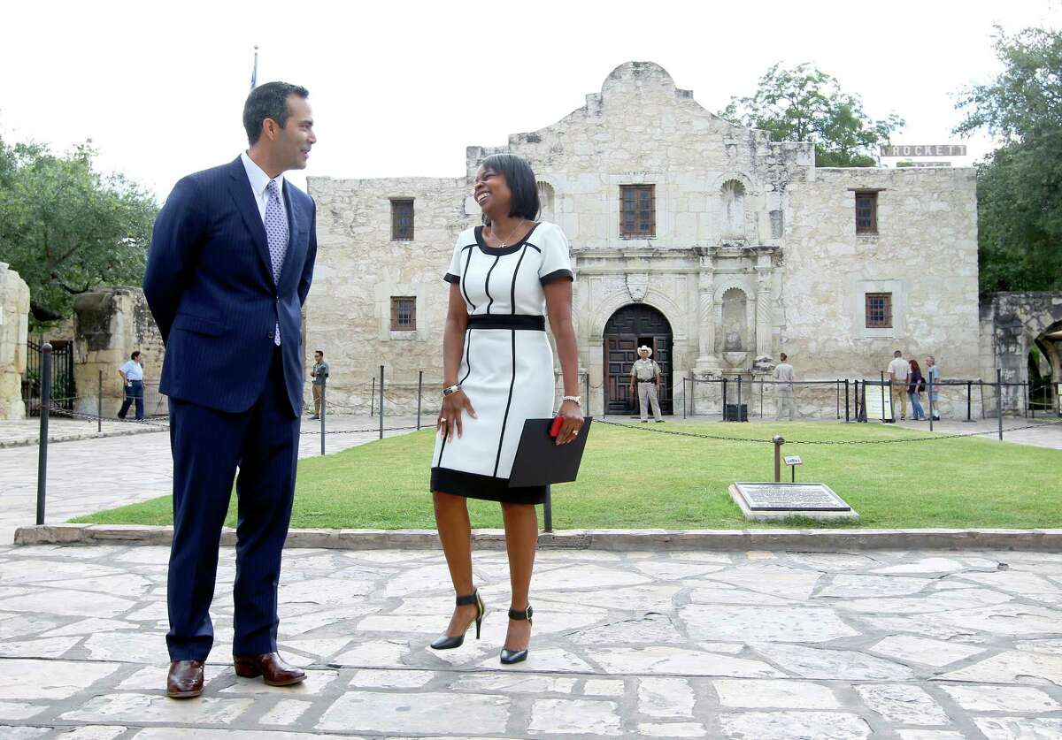 Texas Land Commissioner George P. Bush shares a moment with Mayor Ivy Taylor in front of the Alamo on Wednesday.