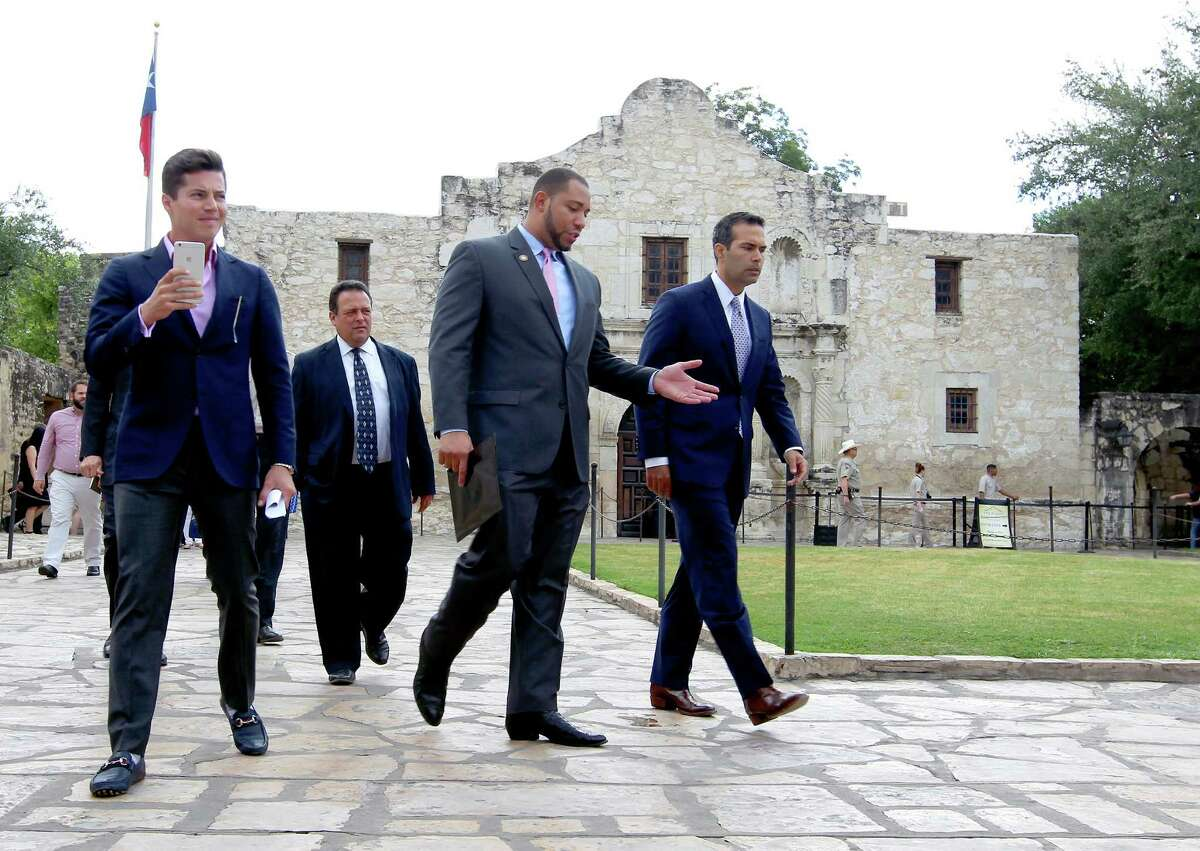 Texas Land Commissioner George P. Bush, right, walks Wednesday Sept. 2, 2015 with County Commissioner Tommy Calvert, second from right, before a brief press conference and a tour of the Alamo grounds. Bush was in San Antonio to celebrate the $31.5 million the General Land Office received to help preserve and develop the Alamo.