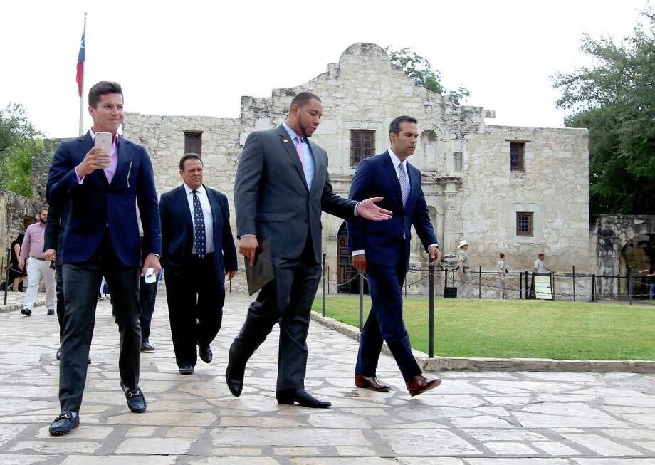 Texas Land Commissioner George P. Bush, right, walks Wednesday Sept. 2, 2015 with County Commissioner Tommy Calvert, second from right, before a brief press conference and a tour of the Alamo grounds. Bush was in San Antonio to celebrate the $31.5 million the General Land Office received to help preserve and develop the Alamo. Photo: William Luther, Staff / San Antonio Express-News / © 2015 San Antonio Express-News