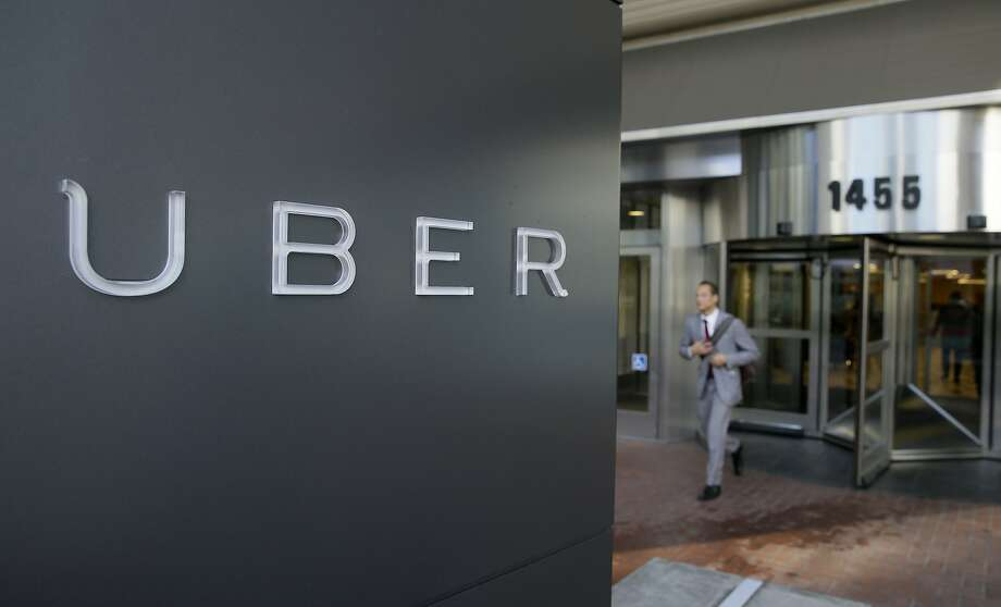 FILE - In this photo taken Tuesday, Dec. 16, 2014, a man leaves the headquarters of Uber in San Francisco. A federal judge granted class-action status Tuesday, Sept. 1, 2015, to a lawsuit in California against Uber over the payment of its drivers, upping the stakes for the ride-hailing company in the case. (AP Photo/Eric Risberg, File) Photo: Eric Risberg, Associated Press