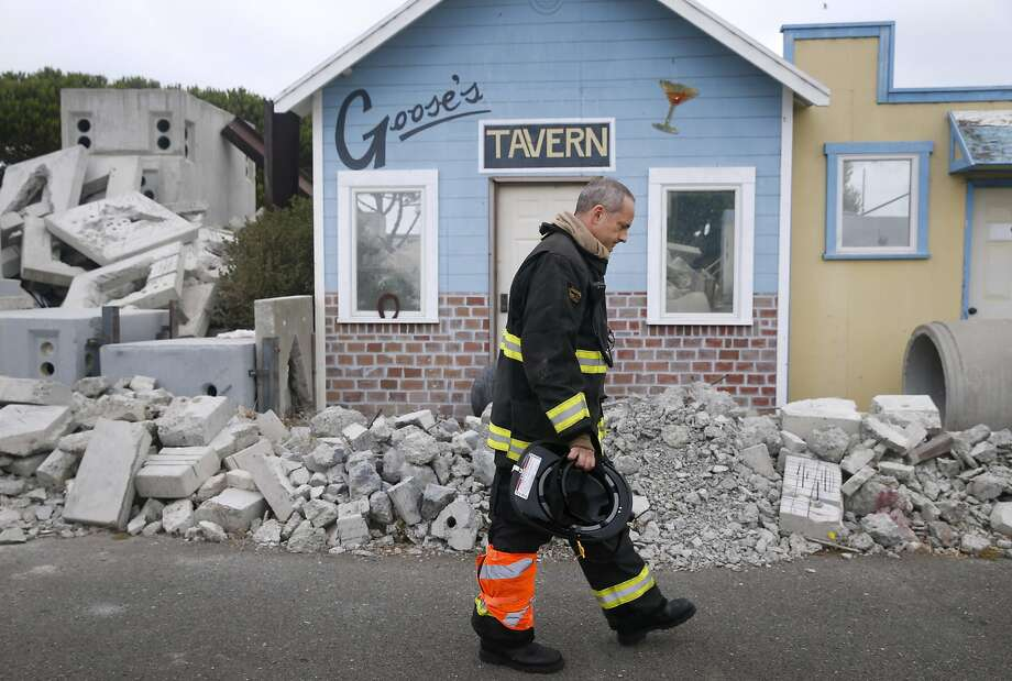 EMS training supervisor Jeff Covitz walks past a Hollywood-style disaster scene at the San Francisco Fire Department's in-service training facility on Treasure Island in San Francisco, Calif. on Wednesday, Sept. 2, 2015. The department will need to find a new home for the training center before it will be forced to surrender the property for planned development within the next 9 years. Photo: Paul Chinn, The Chronicle