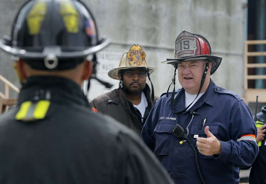 Capt. Jeff Columbini (right) debriefs firefighters after supervising a training exercise at the San Francisco Fire Department's in-service training facility on Treasure Island in San Francisco, Calif. on Wednesday, Sept. 2, 2015. The department will need to find a new home for the training center before it will be forced to surrender the property for planned development within the next 9 years. Photo: Paul Chinn, The Chronicle