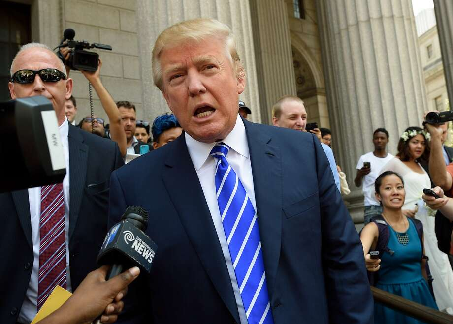 """In this August 17, 2015 file photo, US presidential candidate Donald Trump exits New York Supreme Court after morning jury duty in New York. Trump took aim at Democratic frontrunner Hillary Clinton on August 23, 2015, contending she could be """"very damaged"""" by an email scandal swirling around the former secretary of state. And amid reports that Vice President Joe Biden was actively exploring a run, Trump claimed that if Clinton could """"get over"""" the controversy both would be equally tough challengers. """"I think they're the same. I think that Hillary may be very damaged, however ... because of the email thing,"""" Trump told ABC's """"This Week"""" talk show. AFP PHOTO/DON EMMERT/ FILESDON EMMERT/AFP/Getty Images Photo: Don Emmert, AFP / Getty Images"""
