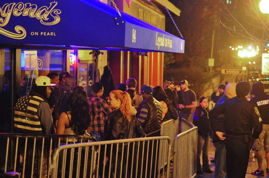 A late-night crowd outside Legends on Pearl in downtown Albany in May 2014. (Photo by Steve Barnes/Times Union.) ORG XMIT: MER2014050316213856