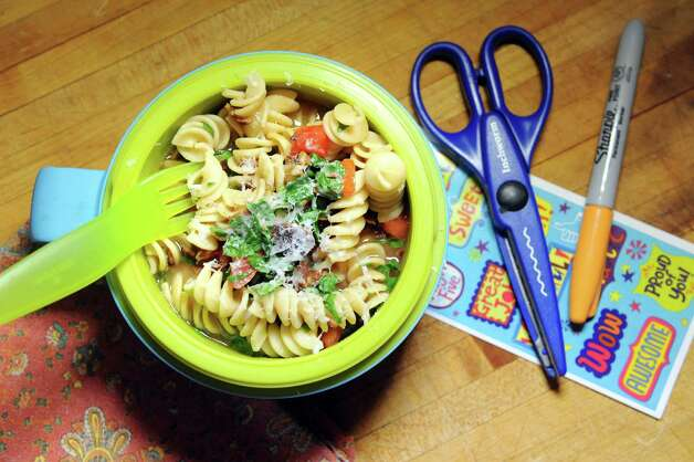 Pasta with bacon, tomato, spinach and parmesan cheese on Friday, Aug. 28, 2015, in Delmar, N.Y. (Cindy Schultz / Times Union) Photo: Cindy Schultz / 00033074A