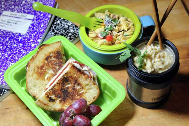 Pepperoni Mozzarella Grill Cheese, left, Pasta with Bacon and veggies, center, and Thai Peanut Ramen Noodles on Friday, Aug. 28, 2015, in Delmar, N.Y. (Cindy Schultz / Times Union) Photo: Cindy Schultz / 00033074A