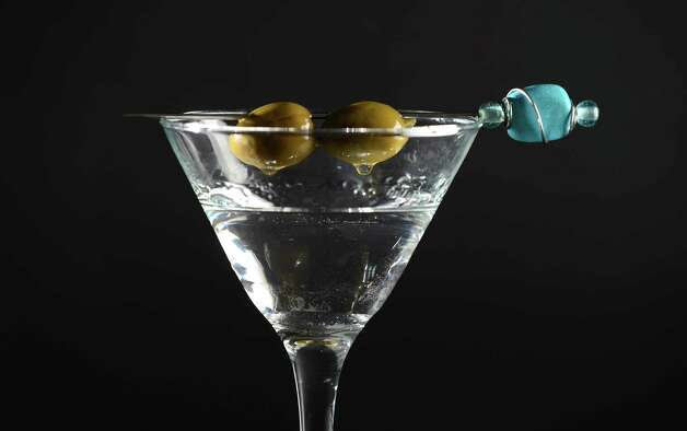 Gin with olives in a Martini glass Friday, July 24, 2015, at the Times Union in Colonie, N.Y. (Will Waldron/Times Union) Photo: WW