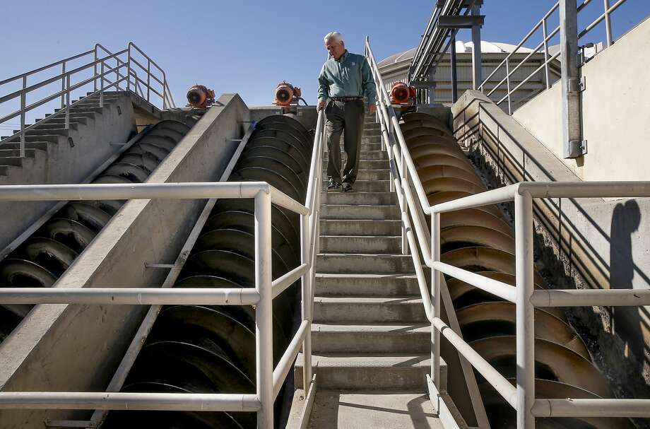 General manager Gary Darling, above giant augers that transport the dirty water to aeration tanks above to begin the cleaning process at the Delta Diablo water district  recycling plant, on Wed. September 2, 2015,  in Antioch, Calif., where 13 million gallons of water is processed every day. Photo: Michael Macor, The Chronicle