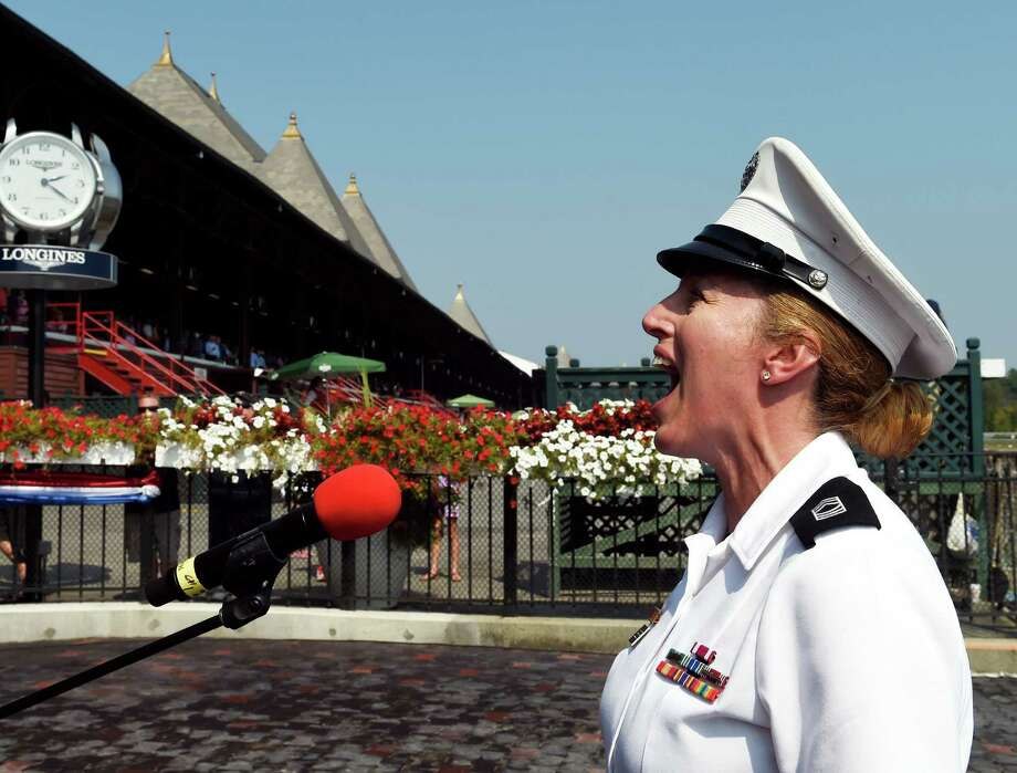 Master Sargent Mary Kay Messenger sings God Bless America on Military Appreciation Day at the Saratoga Race Course Wednesday Sept. 2, 2015  in Saratoga Springs, N.Y.    (Skip Dickstein/Times Union) Photo: SKIP DICKSTEIN