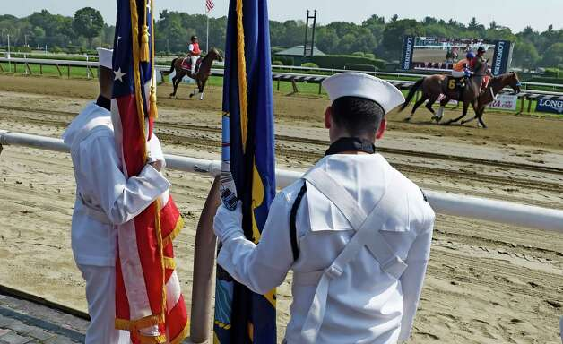 Members of the Naval Reserve Center of Glenville watch the horses parade to post for the second race on the card on Military Appreciation Day  Sept. 2, 2015 at the Saratoga Race Course in Saratoga Springs, N.Y.    (Skip Dickstein/Times Union) Photo: SKIP DICKSTEIN