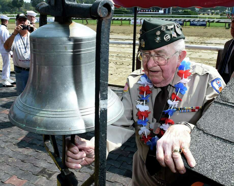 Commemorating the 70th anniversary of VJ Day Sept. 2, 2015 Gene Gierka of Schenectady, a WWII veteran rings the tradition bell seven times at the Saratoga Race Course in Saratoga Springs, N.Y.    (Skip Dickstein/Times Union) Photo: SKIP DICKSTEIN
