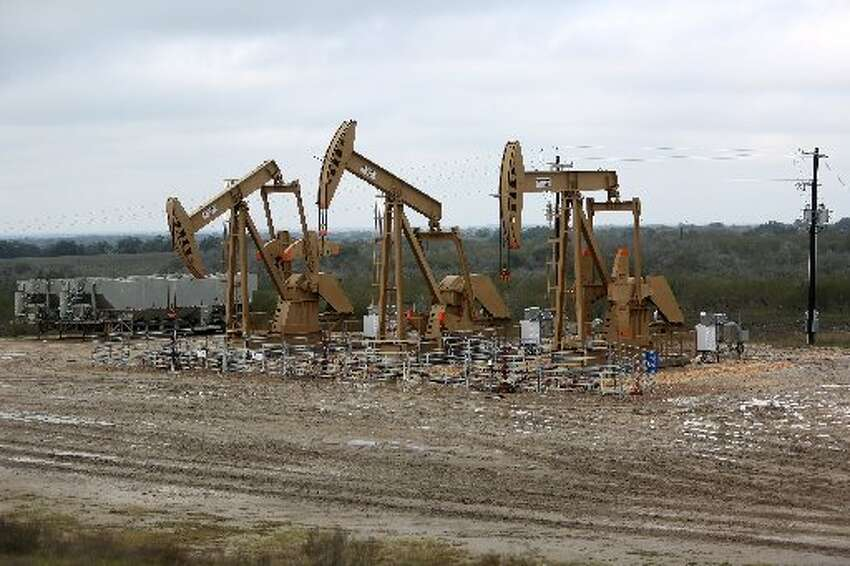 The brushy South Texas plain forms a backdrop for pumpjacks working in the Eagle Ford Shale. (Gary Coronado / Houston Chronicle)