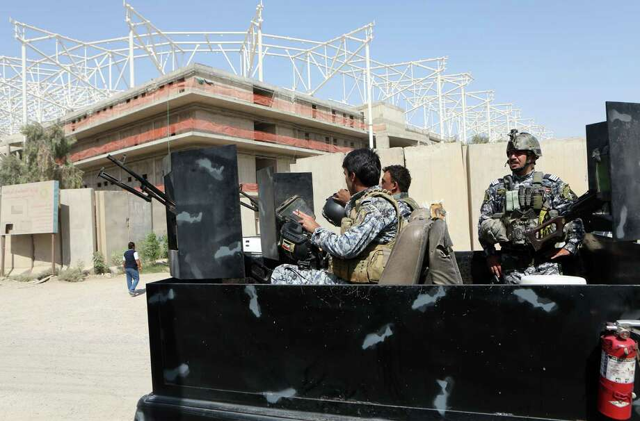 Iraqi security forces guard the entrance to a sports complex being built by a Turkish construction company Wednesday in Baghdad, Iraq. Photo: Khalid Mohammed, STF / AP
