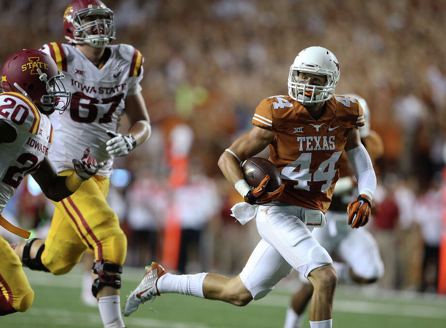UT defensive back Dylan Haines rolls back to the middle of the field and scores on a long return of an interception in the second quarter as Texas hosts Iowa State at Royal-Memorial Stadium on Oct. 18, 2014. Photo: Tom Reel /San Antonio Express-News