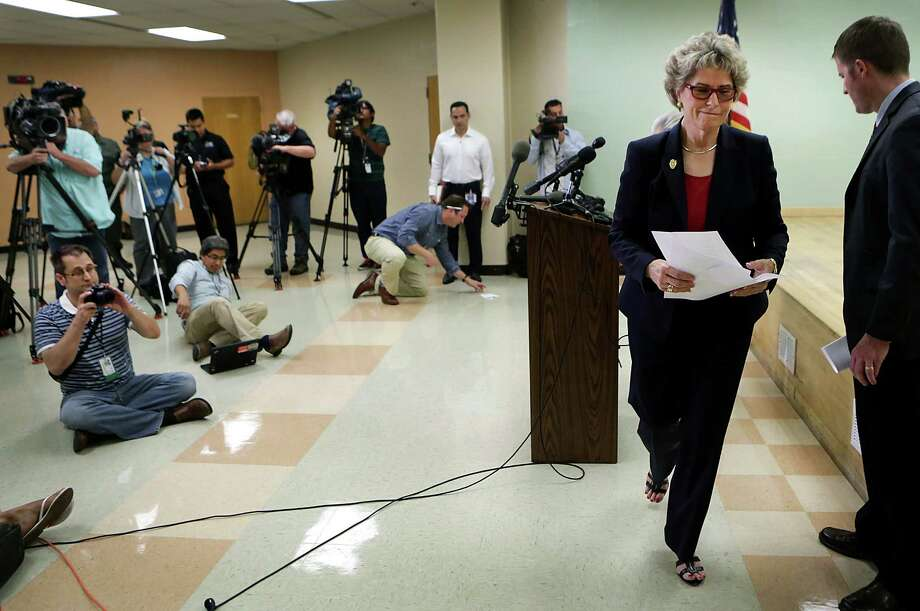 Bexar County Sheriff Susan Pamerleau, right, walks out after holding a press conference at the Bexar County Sheriff's Office on Wednesday, Sept. 2, 2015, dealing with the death of Gilbert Flores who was shot by Sheriff Deputies. Photo: BOB OWEN / San Antonio Express-News / San Antonio Express-News