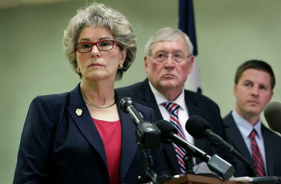Sheriff Susan Pamerleau speaks about the death of Gilbert Flores, shot by sheriff's deputies in August. A state-required report on the death did not mention that Flores had his hands raised above his head when the two deputies opened fire. Photo: Bob Owen / San Antonio Express-News / San Antonio Express-News