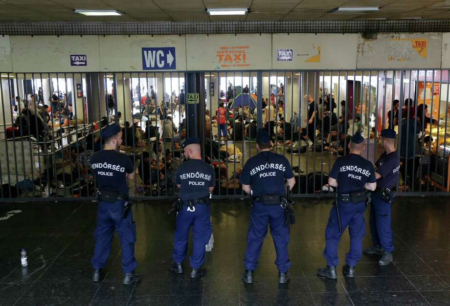 Police on Wednesday guard an entrance to the Keleti Railway Station in Budapest, Hungary, as hundreds of migrants demand to board trains to their destinations in Austria and Germany.  Photo: Petr David Josek, STF / AP