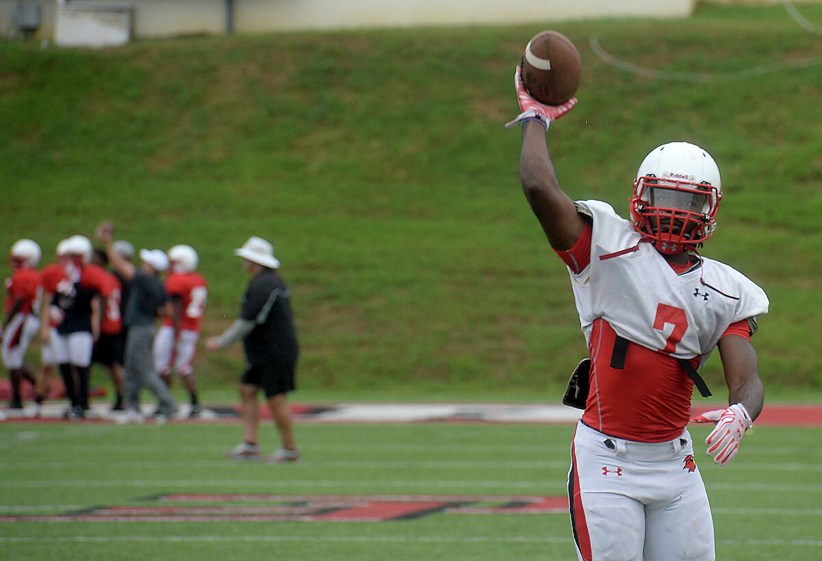 Lamar's receiver Michael Handy throws back a ball as the team runs drills during practice Tuesday at Provost Umphrey Stadium. The Cardinals will hold their first home game Saturday. Photo taken Tuesday, September 1, 2015 Photo by Kim Brent