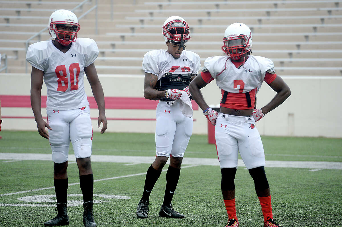 Lamar's Michael Handy (far right) watches teammates complete drills as they get in practice Tuesday at Provost Umphrey Stadium. The Cardinals will hold their first home game Saturday. Photo taken Tuesday, September 1, 2015 Photo by Kim Brent