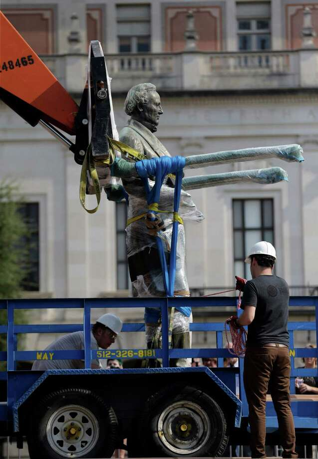 A statue of Confederate President Jefferson Davis is moved from it's location in front of the school's main tower at the University of Texas campus, Sunday, Aug. 30, 2015, in Austin, Texas. The Davis statue, which has been targeted by vandals and had come under increasing criticism, will be moved and placed in the school's Dolph Briscoe Center for American History as part of an educational display. (AP Photo/Eric Gay) Photo: Eric Gay, STF / AP