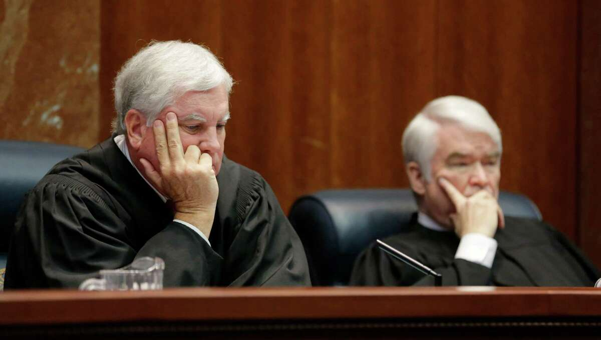 Texas Supreme Court Justices Paul Green, left, and Chief Justice Nathan Hecht listen to oral arguments in Texas' latest school finance trial at the state Supreme Court, Tuesday, Sept. 1, 2015, in Austin, Texas. (AP Photo/Eric Gay)
