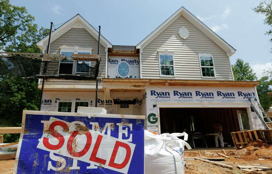 FILE - In this June 8, 2015, file photo, a sold sign is displayed outside a new home under construction in Mechanicsville, Va. The Commerce Department releases new home sales for July 2015 on Tuesday, Aug. 25, 2015. (AP Photo/Steve Helber, File) ORG XMIT: NYBZ927 Photo: Steve Helber / AP