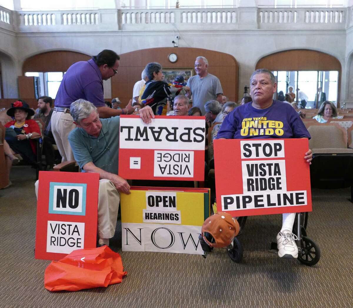 Arturo Hernandez, right, attends City Council's last budget meeting of the year on Wednesday, September 2, 2015. A resident of West San Antonio, he said that streetlights and the proposed Vista Ridge water pipeline are of concern to him. Members of the Texas Organizing Project, SEIU Texas, Esperanza Peace & Justice Center, Southwest Workers Union and West End Hope In Action Organization held a rally outside Council chambers prior to the meeting to advocate for funding for street lights, sidewalks, roads, drainage, and home rehabilitation.