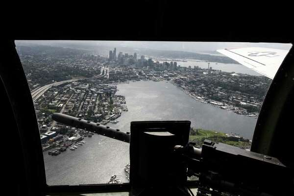A view of downtown Seattle from across one of the side machine guns in Aluminum Overcast, a Boeing B-17 Flying Fortress that will be on display at the Museum of Flight and conducting passenger flights Friday through Monday.
