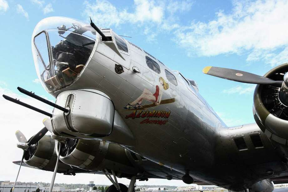 Boeing B-17 Flying Fortress aircraft like this one, pictured Wednesday, Sept. 2 at Boeing Field, dropped more bombs during World War II than any other aircraft. This plane, nicknamed Aluminum Overcast, will be on display and flying passengers for short flights this weekend, hosted by the Cascade Warbirds, a local group that promotes preservation of military aircraft. Photo: DANIEL DEMAY/SEATTLEPI.COM