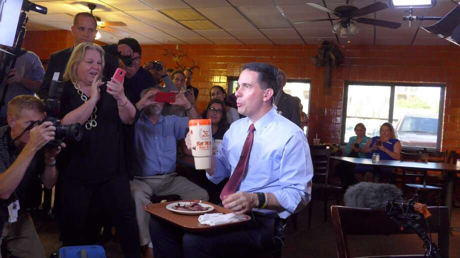 Scott Walker proclaimed his love for barbecue on national television with a giant sweet tea cup in hand.