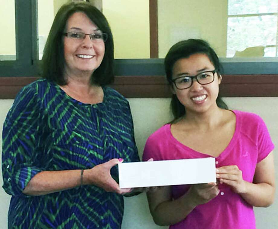 Li Shan Lin, of New Milford, was the winner of an Apple watch raffled recently by the Savings Bank of Danbury during the New Milford Village Fair Days. Presenting the watch is Debbie Hartman, associate vice president and branch manager of Savings Bank of Danbury's Kent Road and Sullivan Road offices in New Milford. Photo: Contributed Photo / The News-Times Contributed