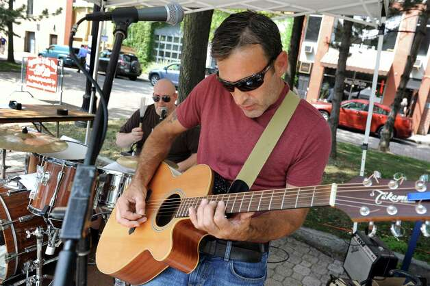 The band Two Guys, comprised of Eric Braymer on guitar, right, and Ron Burris on drums, performs during September in the City Art Fair on Wednesday, Sept. 2, 2015, at Tricentennial Park in Albany , N.Y. The event series features art, music and culture every Wednesday in September from 11:30 a.m. to 2 p.m. (Cindy Schultz / Times Union) Photo: Cindy Schultz / 00033186A
