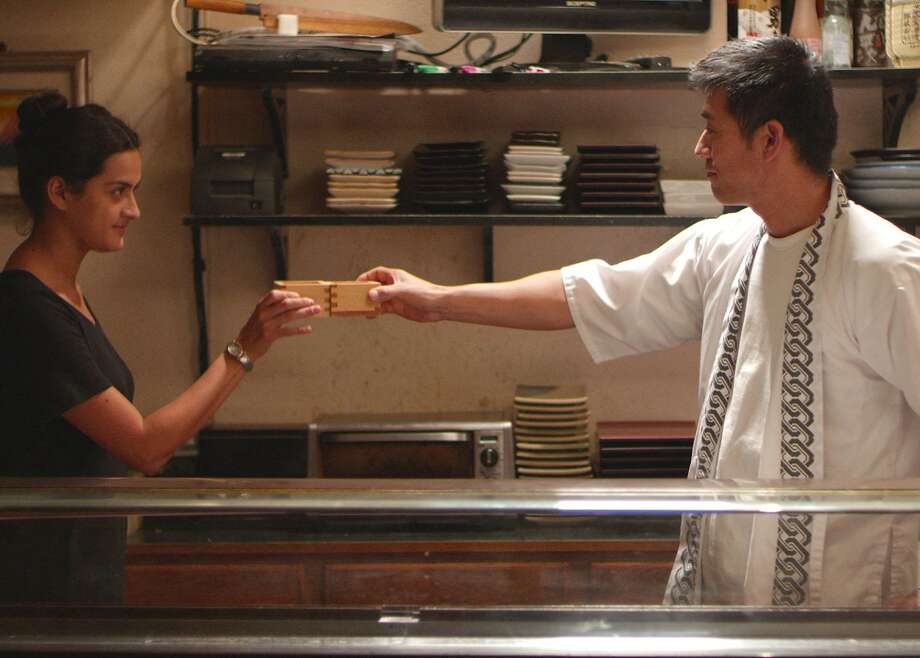 "FROM THE EAST SIDE TO THE ... FAR EAST SIDE Juana (Diana Elizabeth Torres) and Aki (Yutaka Takeuchi) bridge cultures in ""East Side Sushi."" Director Anthony Lucero's feature debut is shot on location in Oakland. Opens Sept. 18.  Credit: Anthony Lucero Photo: Anthony Lucero"