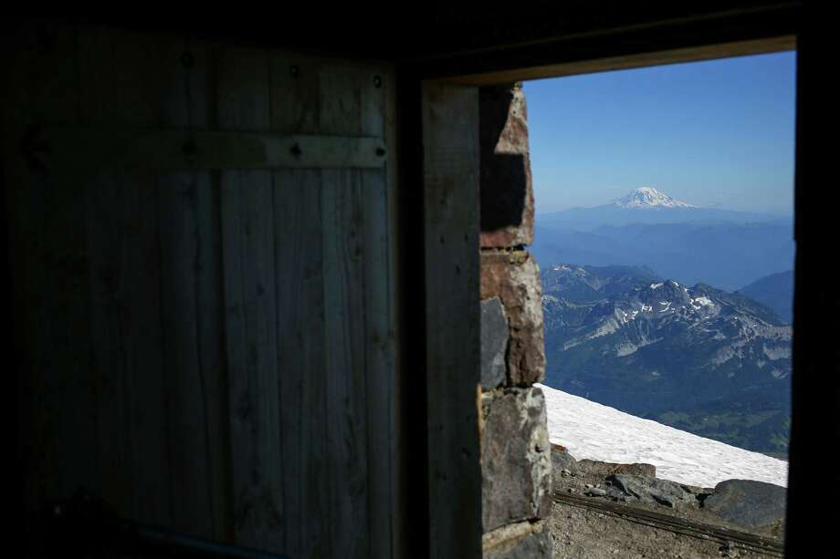 Mount Adams is seen from the historic pubic bunkhouse at Camp Muir on the slopes of Mount Rainier on June 30, 2015. Two people are stranded at Camp Muir Monday and one man is presumed dead after a snow storm swept over the mountain Saturday. Photo: JOSHUA TRUJILLO, Credit / SEATTLEPI.COM