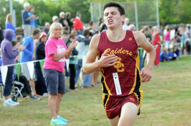 Colonie's Jake Johnson comes in third during the Springstead Invitational Cross Country Meet on Friday, Sept. 12, 2014, at Colonie Town Park in Colonie, N.Y. (Cindy Schultz / Times Union) Photo: Cindy Schultz / 00028531A