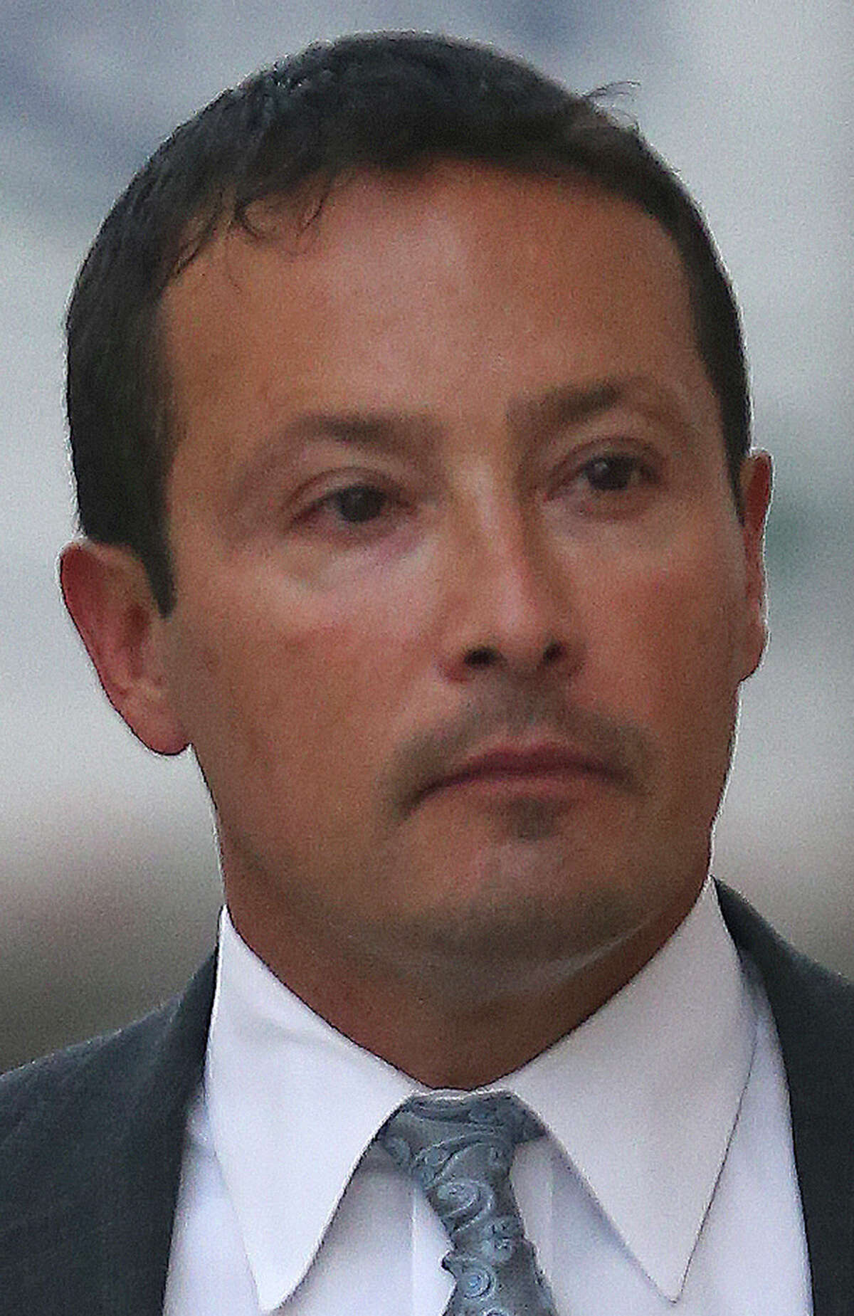 Brian Alfaro approaches the Hipolito Garcia U.S. Courthouse Wednesday September 2, 2015. The court-appointed receiver overseeing two of Alfaro's companies is seeking court permission to pursue potential claims against Alfaro.