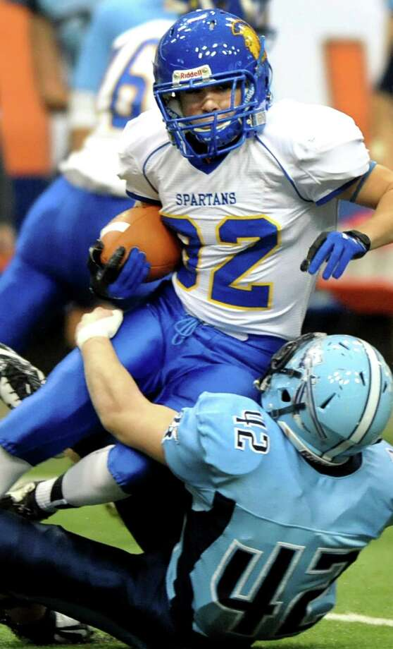 Queensbury's Jared Bruno gains yards as  Indian River's Jeremy Snyder defends during their Class A state football final on Sunday Nov. 30, 2014, at the Carrier Dome in Syracuse, N.Y. (Cindy Schultz / Times Union) Photo: Cindy Schultz / 00029663A