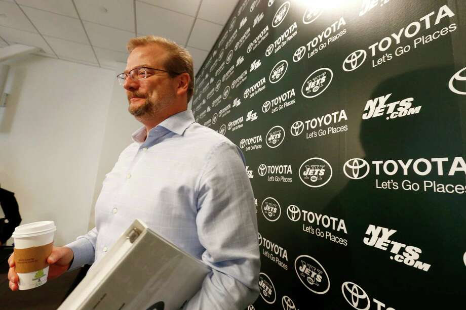 FILE - In this April 24, 2015, file photo, New York Jets general manager Mike Maccagnan speaks to reporters after an NFL football news conference in Florham Park, N.J. The 48-year-old Maccagnan is the man charged with returning the franchise to respectability after owner Woody Johnson made sweeping changes following a fourth straight season without making the playoffs.  (AP Photo/Julio Cortez, File) ORG XMIT: NY155 Photo: Julio Cortez / AP