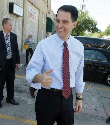 Republican presidential candidate Wisconsin Gov. Scott Walker greets supporters in Dallas. Photo: LM Otero, STF / AP